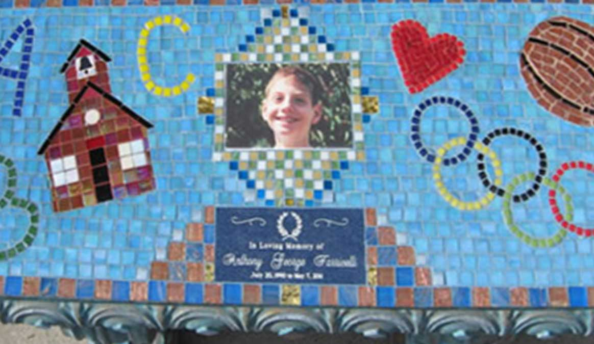 Mosaic Memorial Garden Bench with Portrait Tiles of Anthony's School, Ball and Symbols Closeup by Water's End Studio Artist Linda Solby