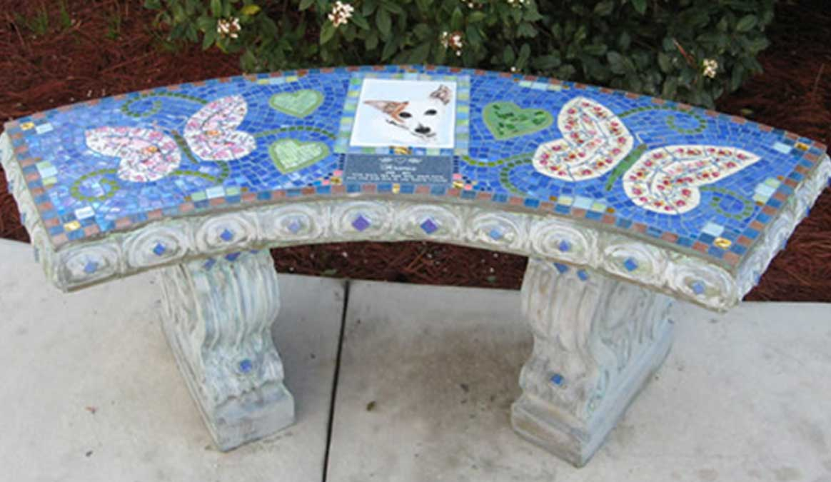 Mosaic Memorial Garden Bench with Portrait Tiles of Aramis' Buterflies and Hearts with handpainted portrait tile by Water's End Studio Artist Linda Solby