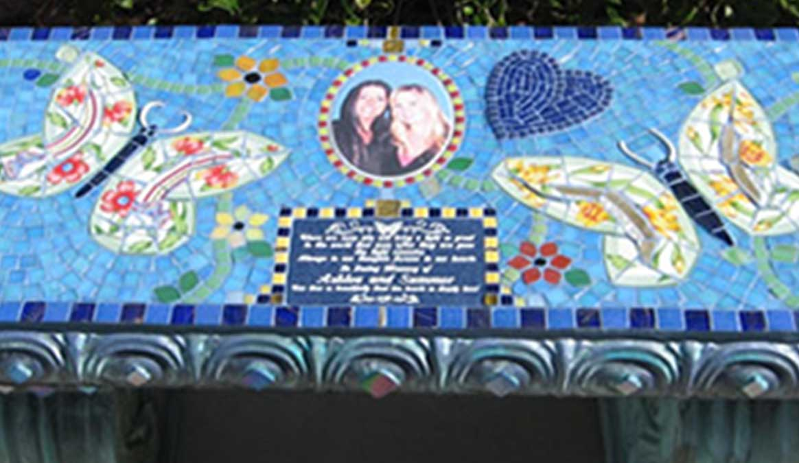 Mosaic Memorial Garden Bench with Portrait Tiles of Ashlea's and Summer's Butterflies Closeup by Water's End Studio Artist Linda Solby