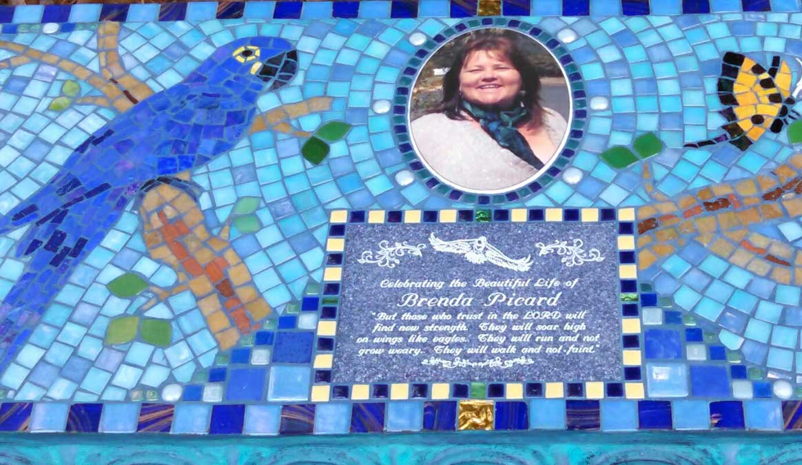 Mosaic Memorial Garden Bench with Portrait Tiles of Brenda's Blue Parrot and Butterflies Closeup by Water's End Studio Artist Linda Solby