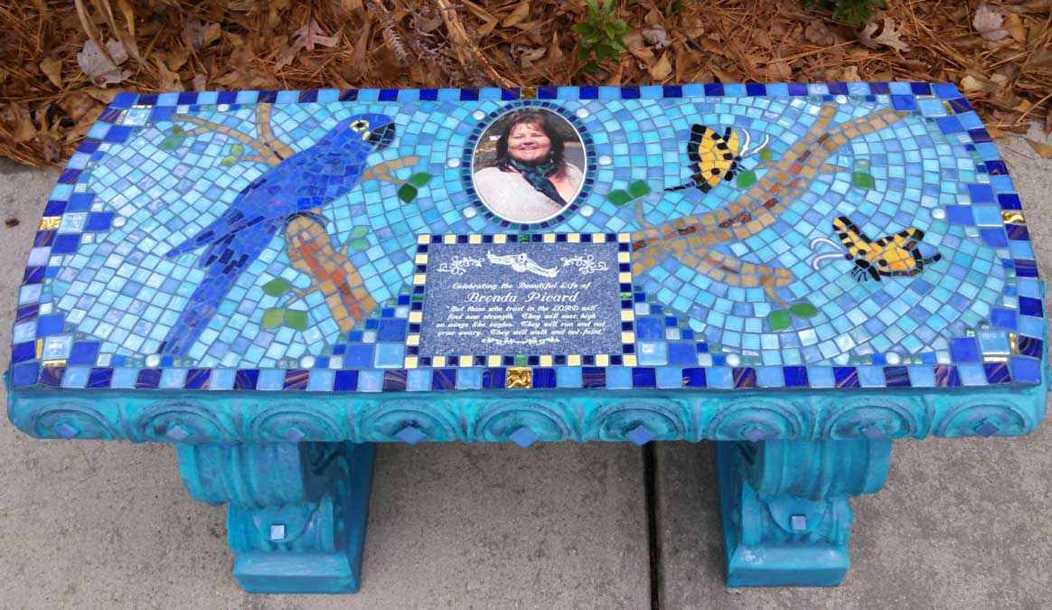 Mosaic Memorial Garden Bench with Portrait Tiles of Brenda's Blue Parrot and Butterflies by Water's End Studio Artist Linda Solby