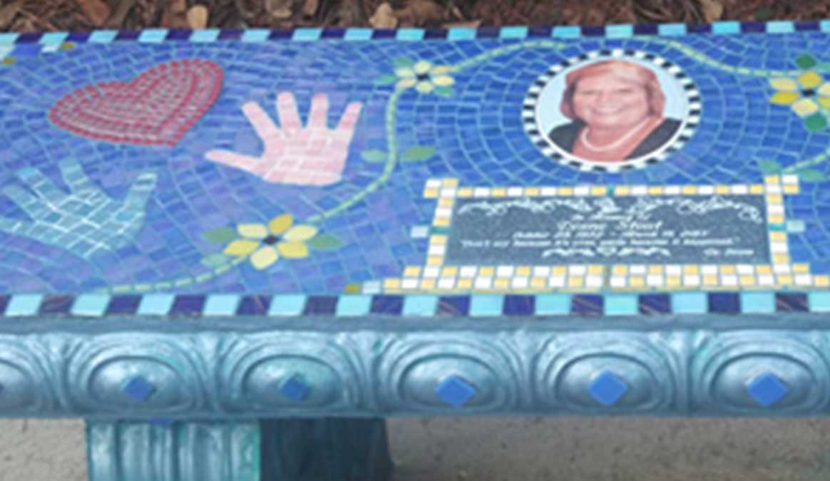 Mosaic Memorial Garden Bench with Portrait Tiles of Diane's Hands, Heart and Symbols Closeup by Water's End Studio Artist Linda Solby