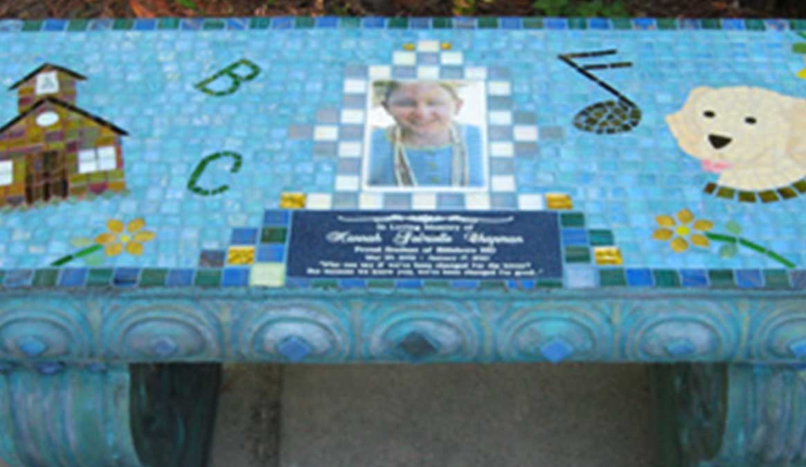 Mosaic Memorial Garden Bench with Portrait Tiles of Hannah's School, Dog and Music Symbols Closeup by Water's End Studio Artist Linda Solby