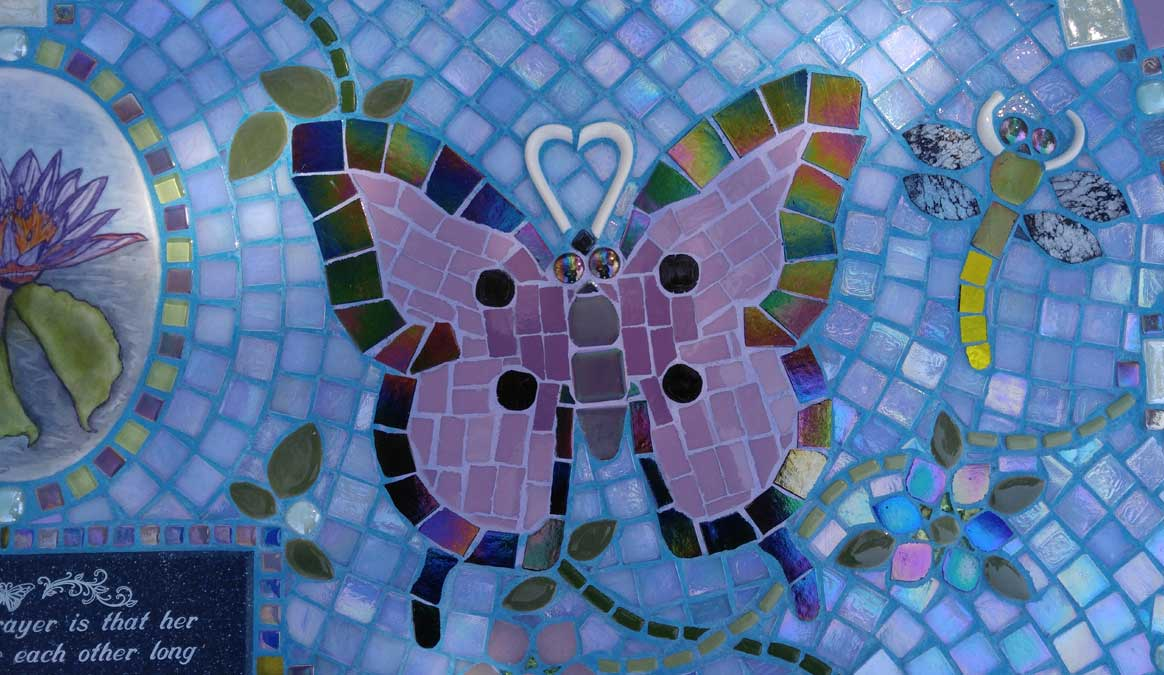 Mosaic Memorial Garden Bench of Justine's Lotus Flower with Butterflies and Dragonflies Closeup by Water's End Studio Artist Linda Solby