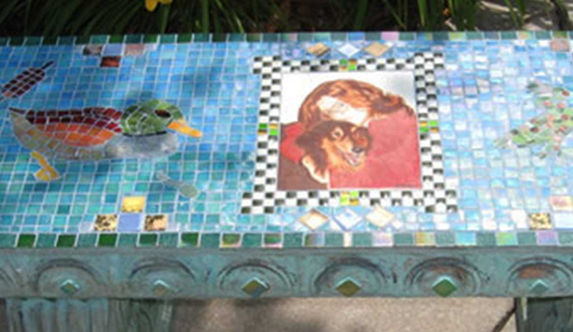 Mosaic Memorial Garden Bench with Portrait Tiles of Kyle's Lake with Duck and Frog Closeup by Water's End Studio Artist Linda Solby