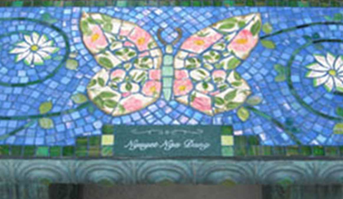Mosaic Memorial Garden Bench of Green and PInk Butterfly Closeup by Water's End Studio Artist Linda Solby