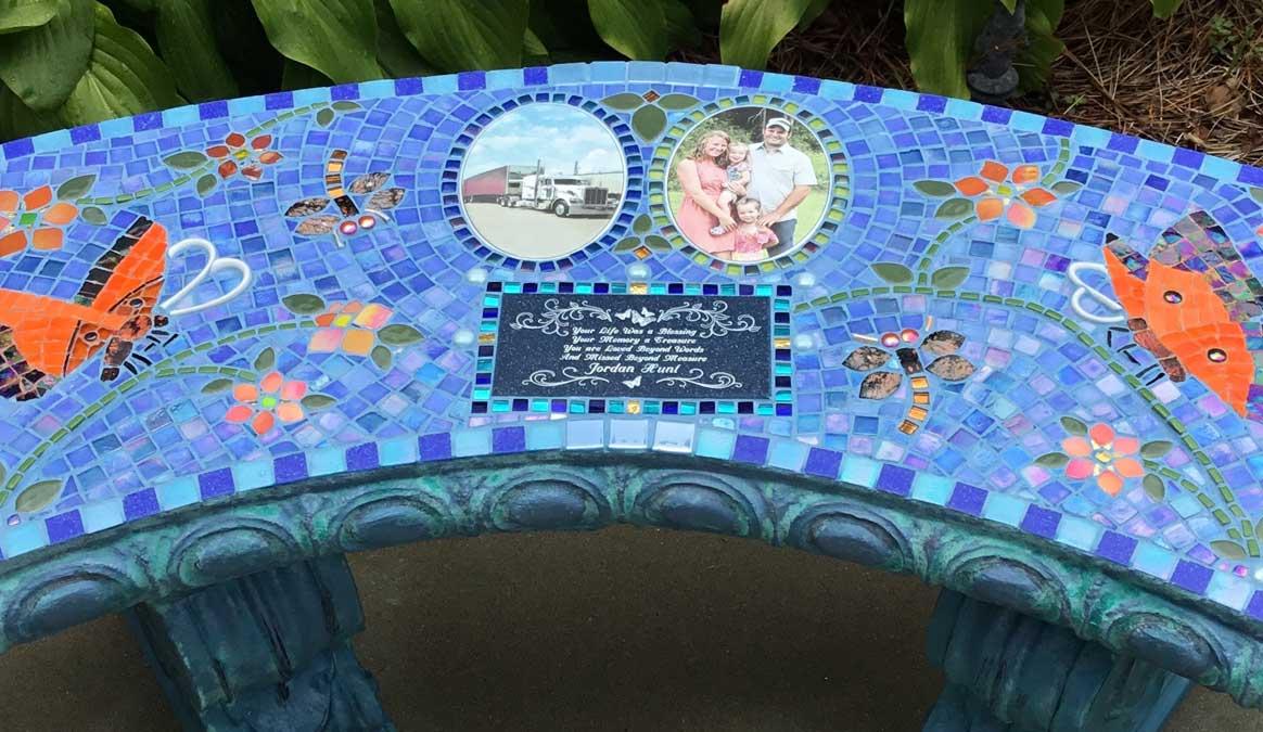 Mosaic Memorial Garden Bench with Portrait Tiles of Jordan's Orange Butterflies Closeup by Water's End Studio Artist Linda Solby