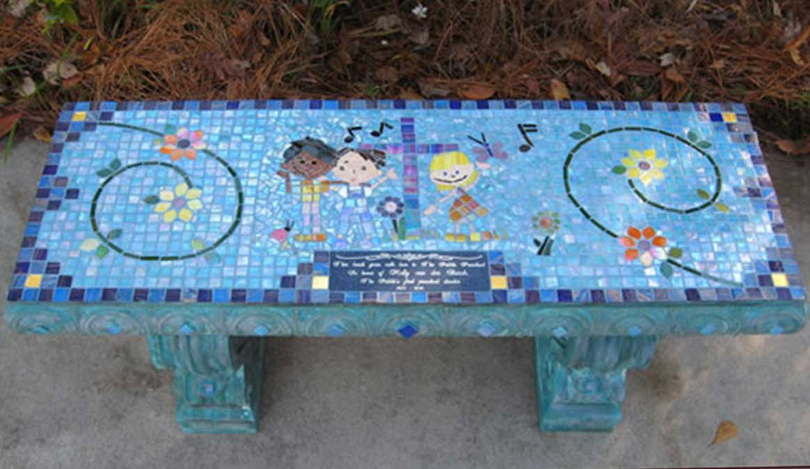 Mosaic Memorial Garden Bench of Molly's Art Bench featuring the Pebble Preschool Logo in Mosaic by Water's End Studio Artist Linda Solby